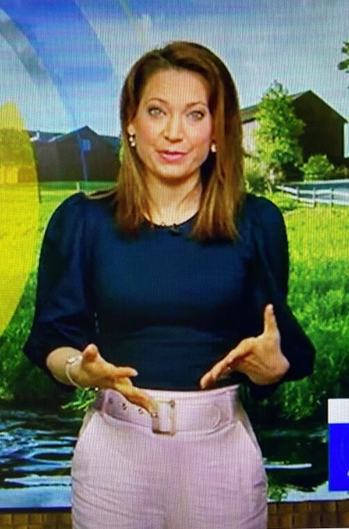 Ginger's navy puff sleeve top and pink belted pants on Good Morning America