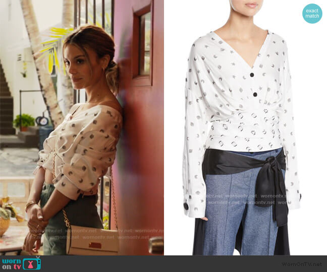 Sphinx V-Neck Cosmic-Print Fil Coupe Blouse by Hellessy worn by Noa Hamilton (Nathalie Kelley) on The Baker & the Beauty