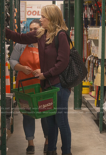 Jen's black quilted tote bag on Dead to Me