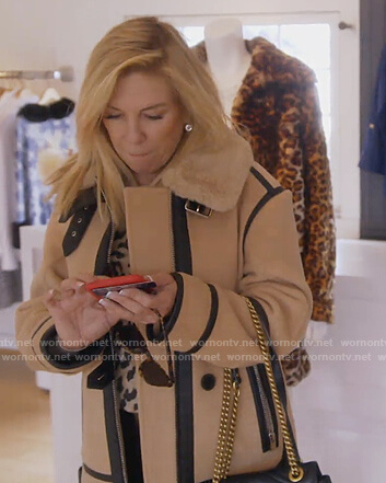 Ramona's beige contrast trim coat on The Real Housewives of New York City