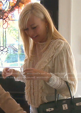 Sutton's white lace panel ruffle blouse on The Real Housewives of Beverly Hills