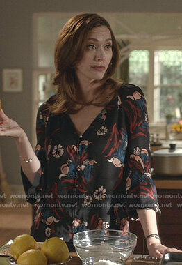 Abigail's black floral v-neck blouse on Good Witch