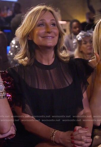 Sonja's black sheer ruffle dress and bow earrings on The Real Housewives of New York City
