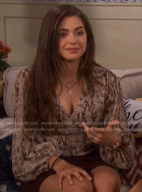 Ciara's snake print wrap top on Days of our Lives