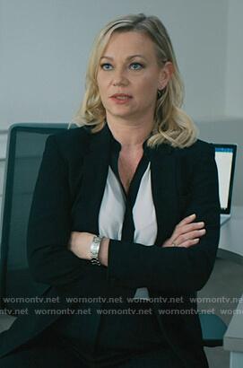 Sara's white contrast blouse on Billions
