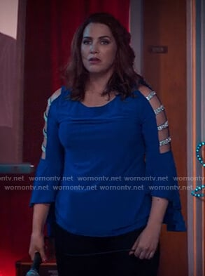 Cyndee's blue embellished cutout sleeve top on Unbreakable Kimmy Schmidt