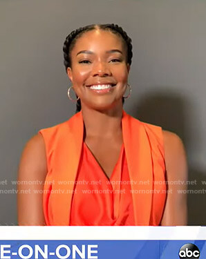 Gabrielle Union's orange cowl neck top and vest on Good Morning America