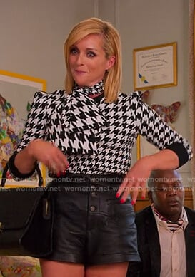Jacqueline's houndstooth tie neck top and leather shorts on Unbreakable Kimmy Schmidt