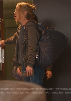 Jen's blue quilted travel bag on Dead to Me