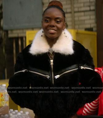 Josie's black zip front fur jacket on Katy Keene