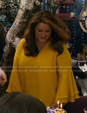 Katie's yellow bell sleeve blouse on American Housewife