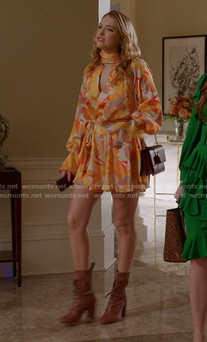 Kirby's orange abstract print mini dress on Dynasty