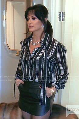 Kyle's black star print tie neck blouse on The Real Housewives of Beverly Hills