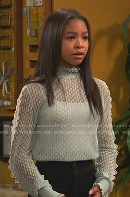 Nia's aqua blue sheer sweater on Ravens Home