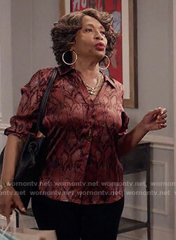 Ruby's red metallic snakeskin blouse on Black-ish