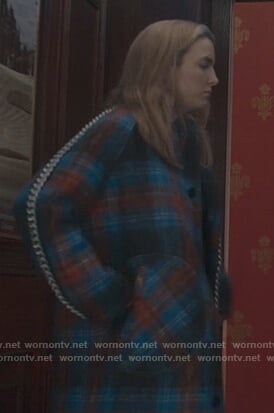 Villanelle's blue plaid coat and chain trim skirt on Killing Eve