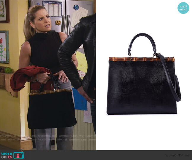 PU Leather Cross Body Bag with Bamboo Handle by Celaine worn by Stephanie Tanner (Jodie Sweetin) on Fuller House