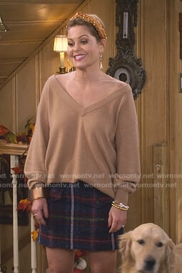 DJ's camel mesh panel sweater and plaid skirt on Fuller House