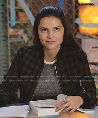 Estela's checked bomber jacket on 13 Reasons Why