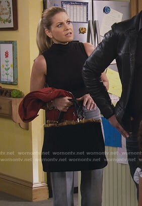 Stephanie's black bamboo handle bag on Fuller House