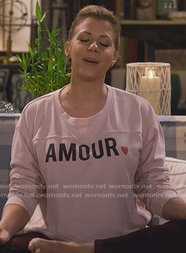 Stephanie's pink amour sweatshirt on Fuller House