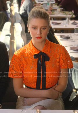 Alice's orange lace dress with black tie on The Politician