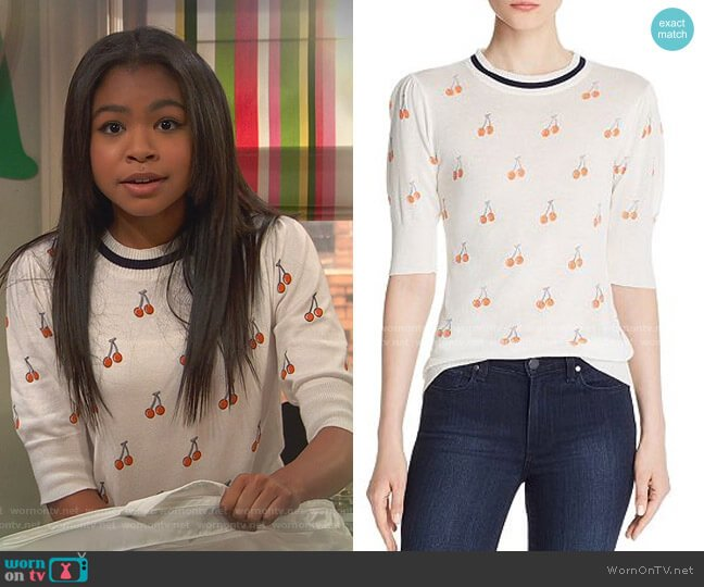 Puff-Sleeve Cherry Print Top by Aqua worn by Nia Baxter (Navia Robinson) on Ravens Home