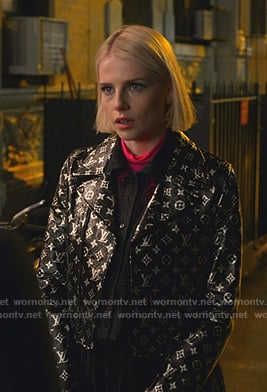 Astrid's black metallic monogram print moto jacket on The Politician