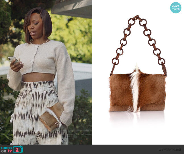 Springbok Billfold Bag by Brother Vellies worn by Molly Carter (Yvonne Orji) on Insecure