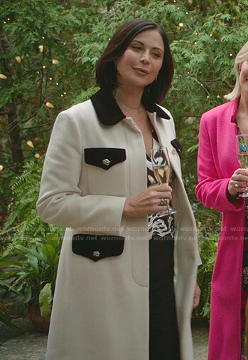 Cassie's white contrast detail coat on Good Witch