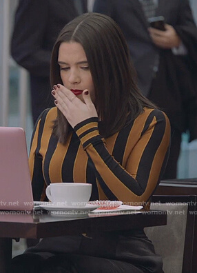 Jane's black and orange striped sweater on The Bold Type