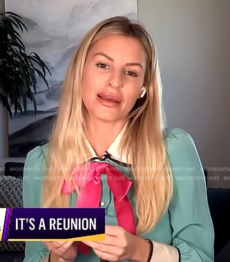 Morgan's green blouse with pink bow on E! News Nightly Pop