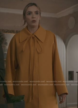 Villanelle's yellow tie neck coat on Killing Eve