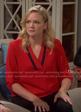 Belle's red contrast v-neck blouse on Days of our Lives