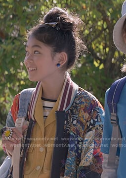 Claudia's mixed print bomber jacket on The Baby-Sitters Club