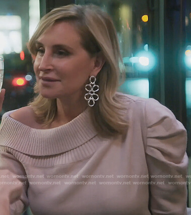 Sonja's pink off shoulder sweater on The Real Housewives of New York City