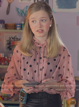Stacey's pink sheer dotted top on The Baby-Sitters Club