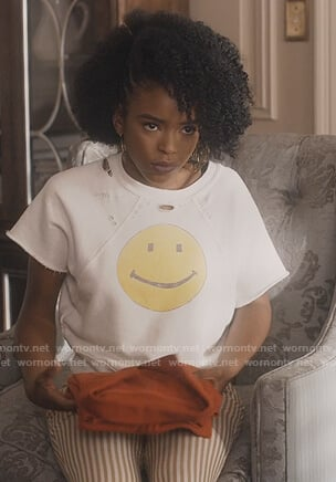 Zora's white smiley face sweatshirt on Greenleaf