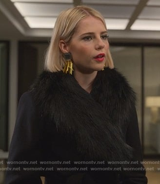 Astrid's black coat with fur collar on The Politician