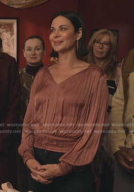 Cassie's pink v-neck pleated top on Good Witch