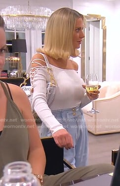 Dorit's white lace-up sleeve top and jeans on The Real Housewives of Beverly Hills