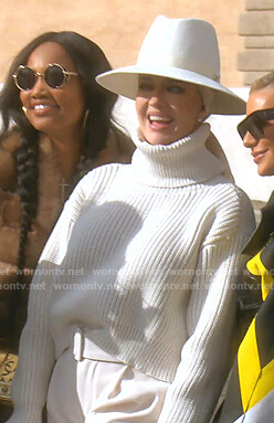 Erika's white ribbed turtleneck sweater and belted pants on The Real Housewives of Beverly Hills