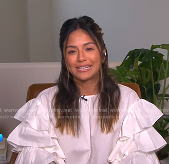 Erin's white ruffle-sleeve blouse on E! News Daily Pop