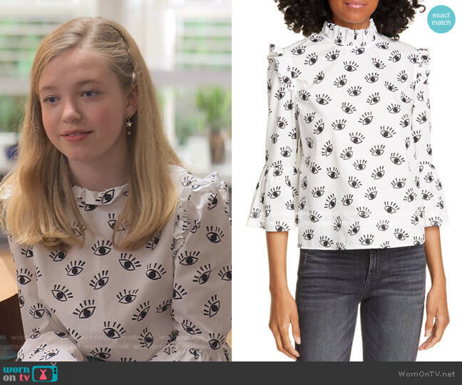 Henrietta Eye Pattern Ruffled Cotton Boxy Blouse by Alice + Olivia worn by Stacey McGill (Shay Rudolph) on The Baby-Sitters Club