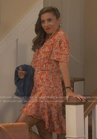Jo's orange floral print dress on United We Fall