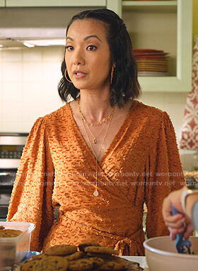 Joyce's orange leopard wrap top on Never Have I Ever