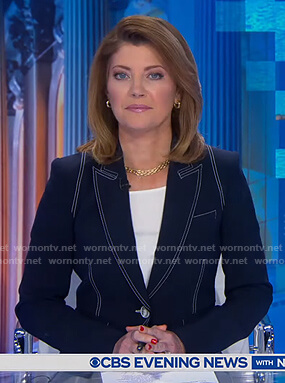 Norah's navy blazer with white stitching on CBS Evening News