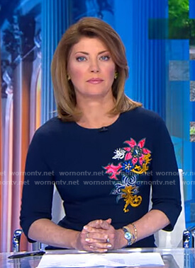 Norah's navy floral embroidered dress on CBS Evening News