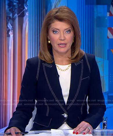 Norah's navy blazer with white stitching on CBS Evening News