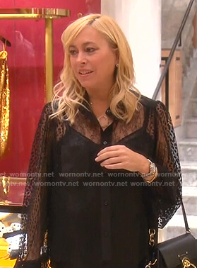 Sutton's black floral lace blouse and red studded sneakers on The Real Housewives of Beverly Hills